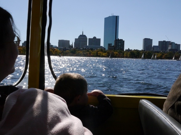 Anthony admires the Boston skyline from the Charles River.