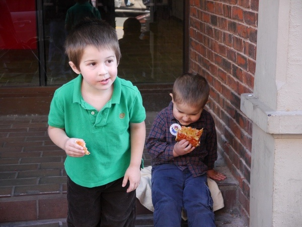 Anthony and Ben eating pizza.