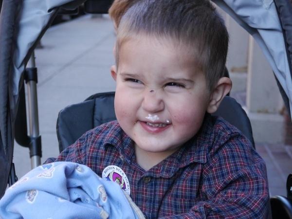 Anthony smiles.