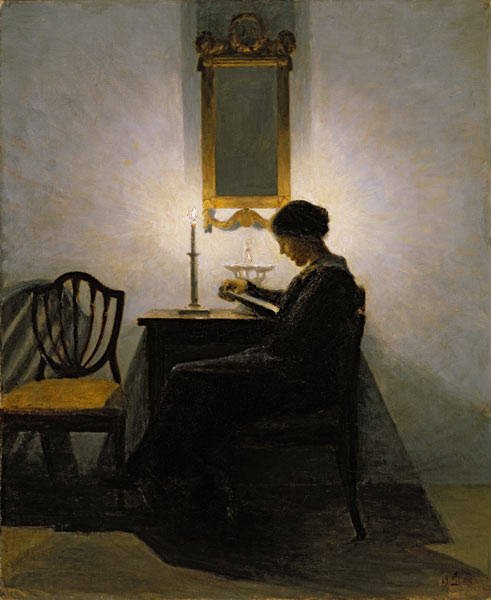 Woman Reading by Candlelight by Peter Ilsted