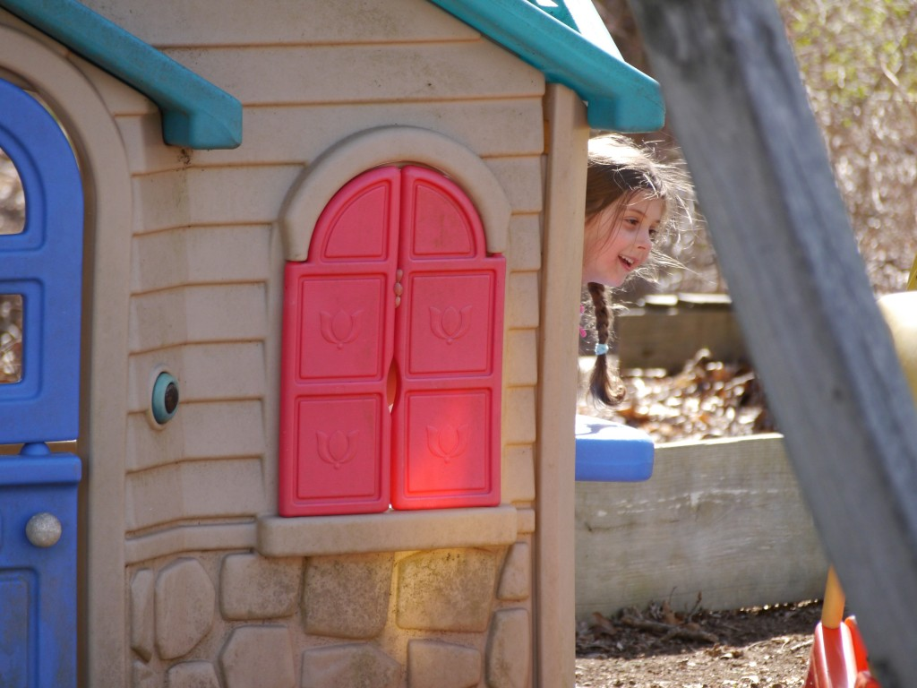 Sophie hiding in the playhouse at her cousins' house