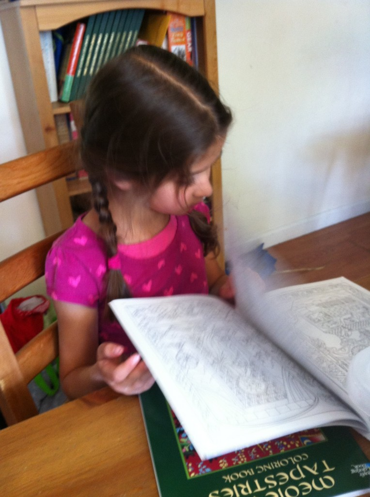 Bella examines her new Illuminated Manuscripts coloring book. Thanks, Grandma and Grandad!