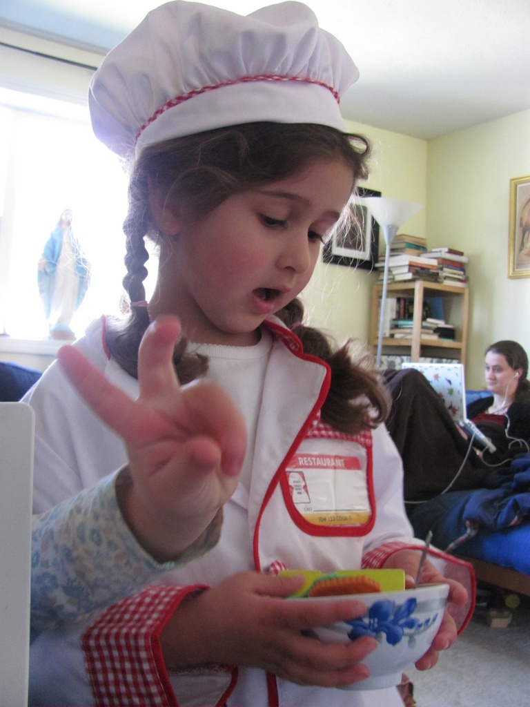 A really old picture of Chef Bella. Sophie's toddler hand flashing the number two.