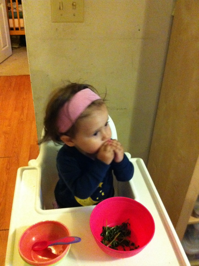 Lucy eats pea tendrils