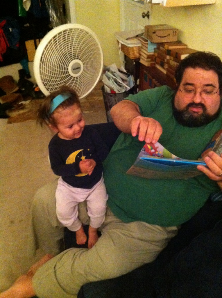 Lucy reads bedtime story with Daddy