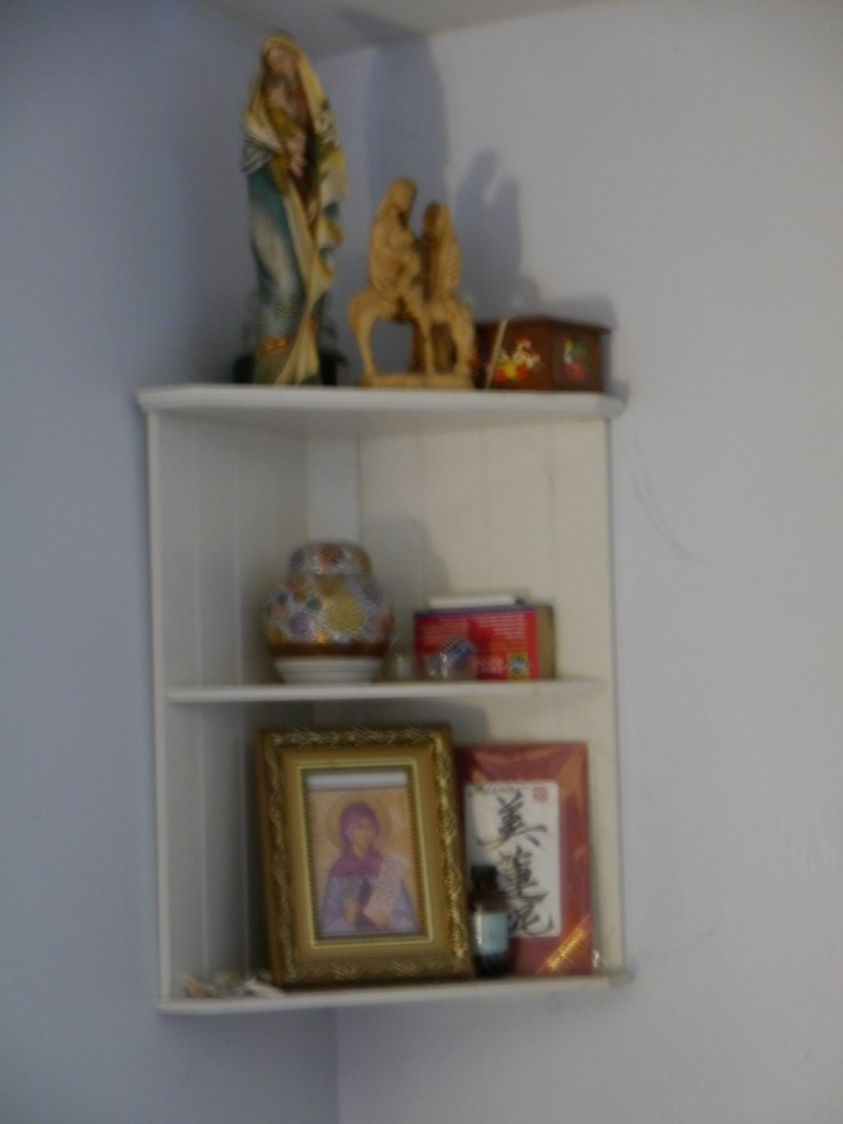 Corner shelf in master bedroom: St Melanie icon, Madonna and Child and Flight to Egypt statues. The box also has an image of the nativity and the vase was my grandmother's.