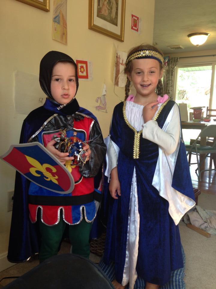 Sir Ben shows off his new knight toys with Lady Sophia.