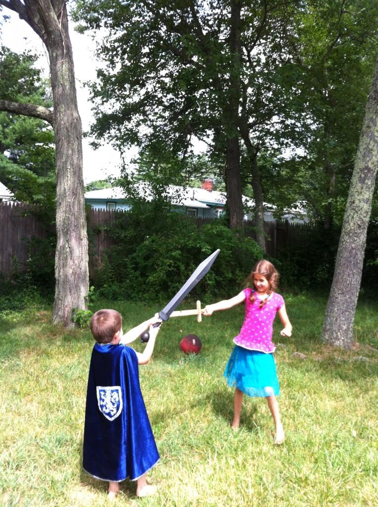 Bella and Ben cross swords