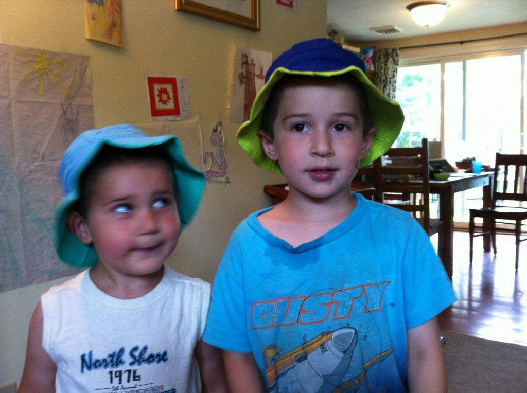 Ben and Anthony wearing new hats from Grandma Scott