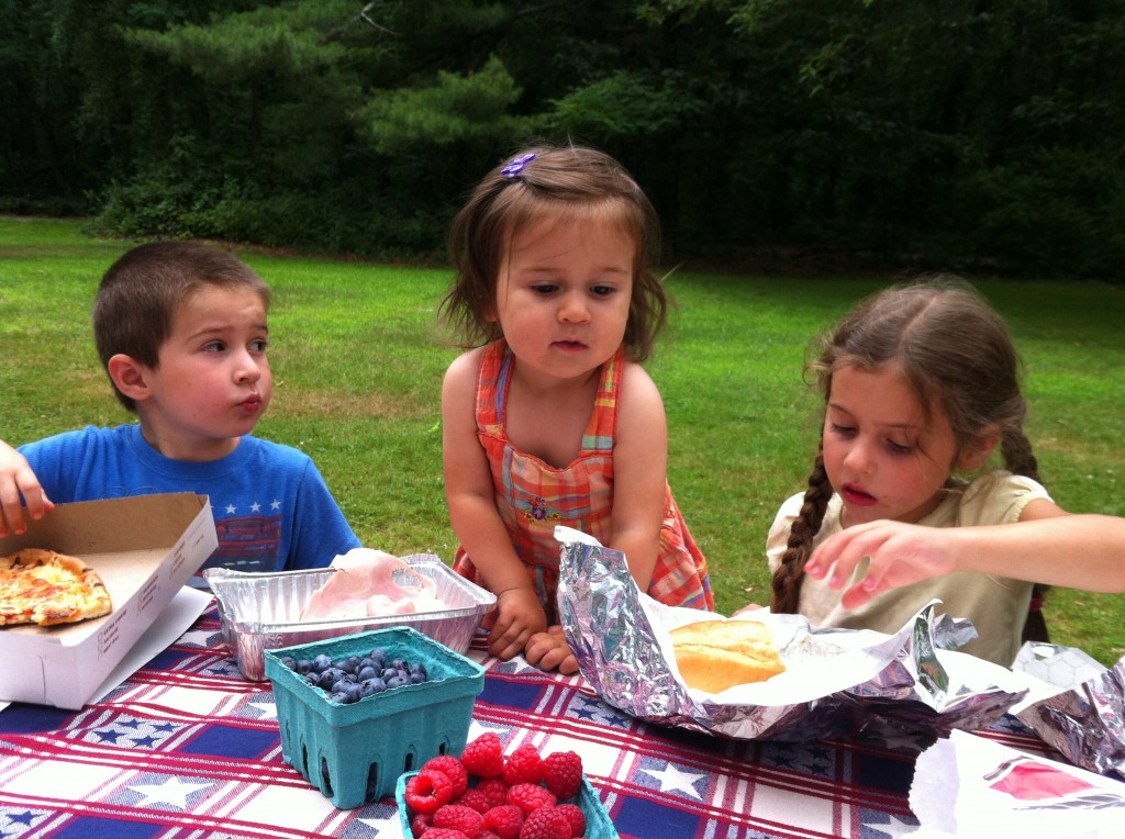 Picnic at Wampatuck State Park: Lucy eyes Sophie's burger.