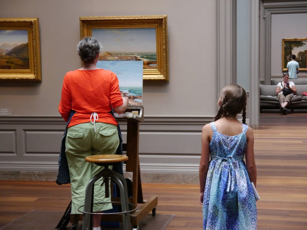 Isabella watches a painter at work in the National Gallery of Art