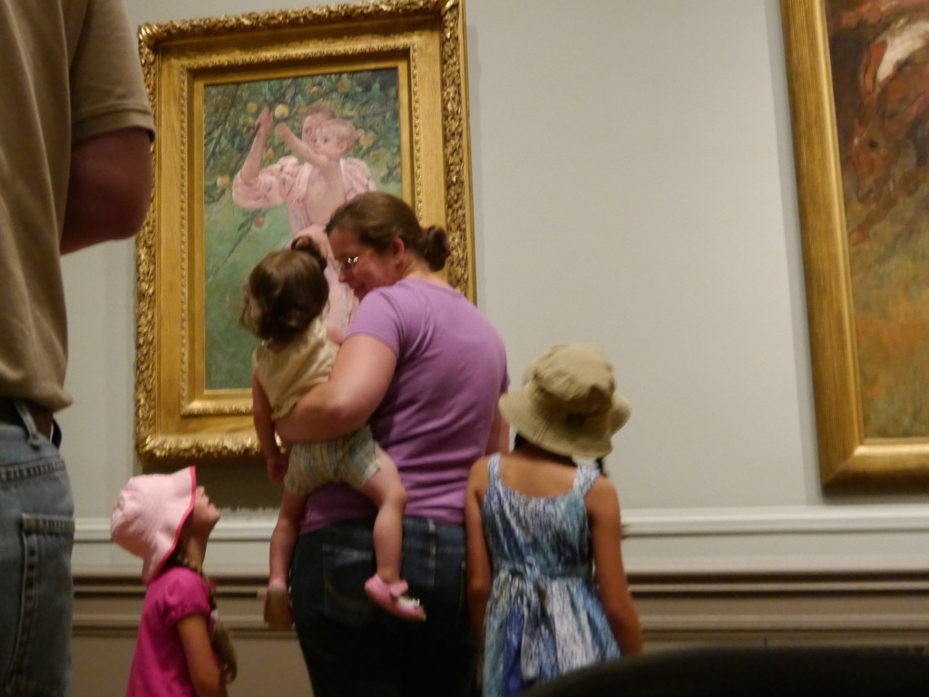"Melanie and Lucia in front of Cassatt's ""Baby Reaching for an Apple""."