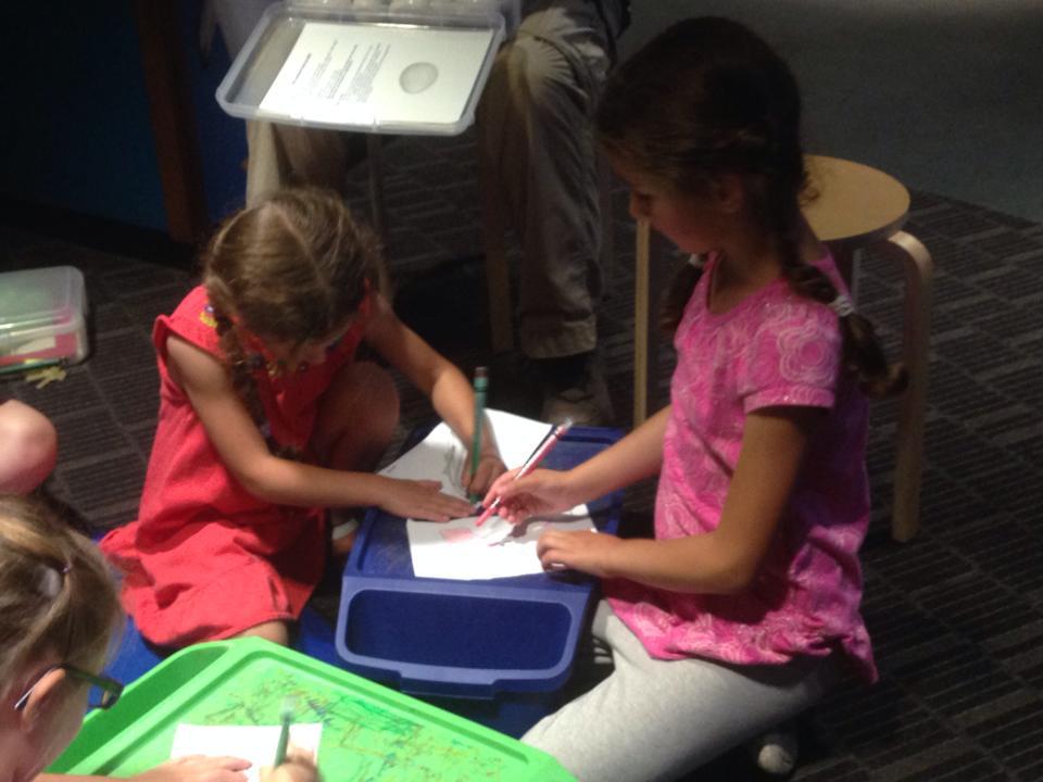 Bella and Sophie drawing at the Aquarium