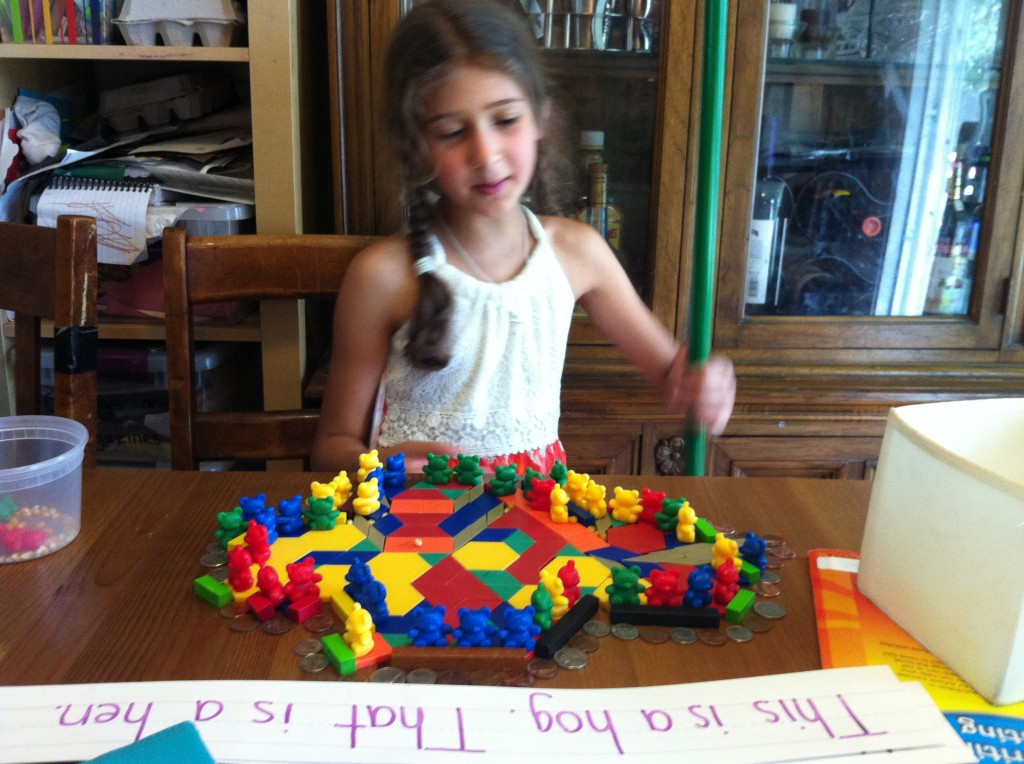 Bella plays with manipulatives