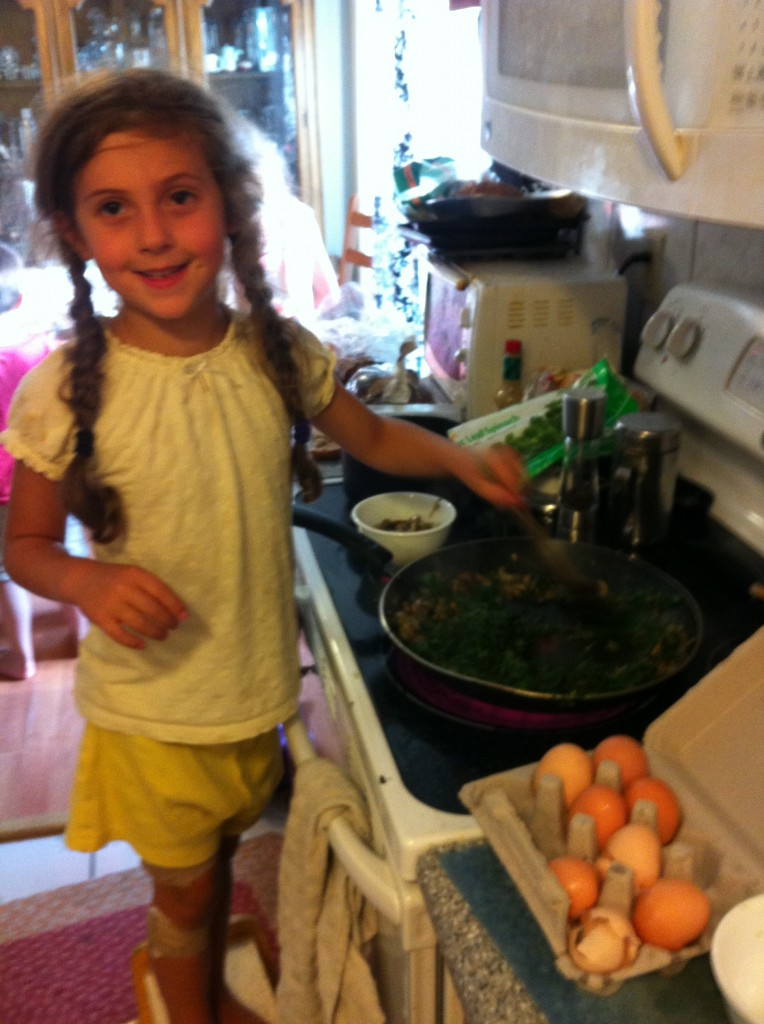 Sophie helps cook the spinach quiche