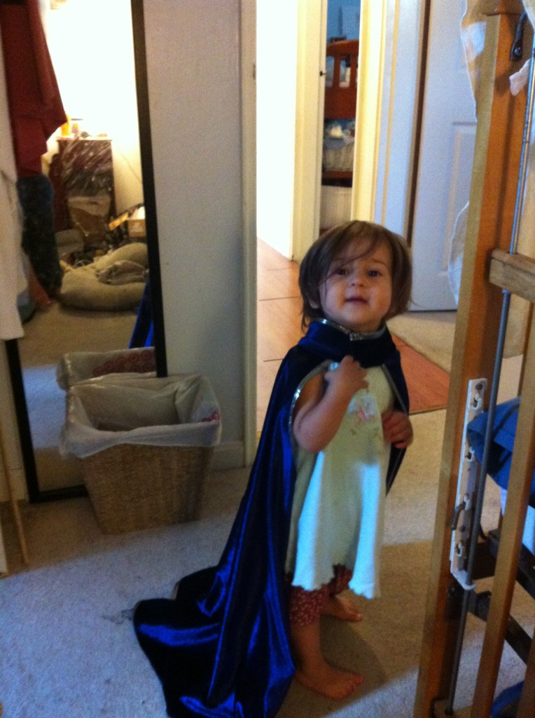 Lucy in a cape.