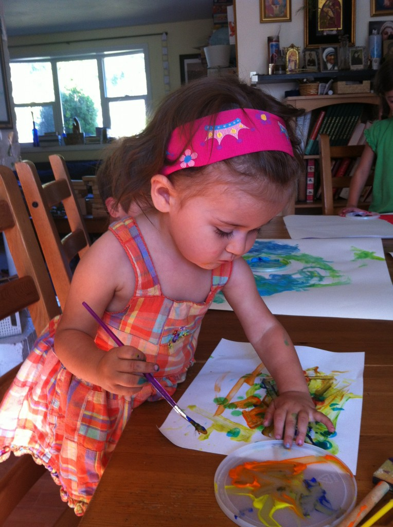 Lucy paints for the first time.