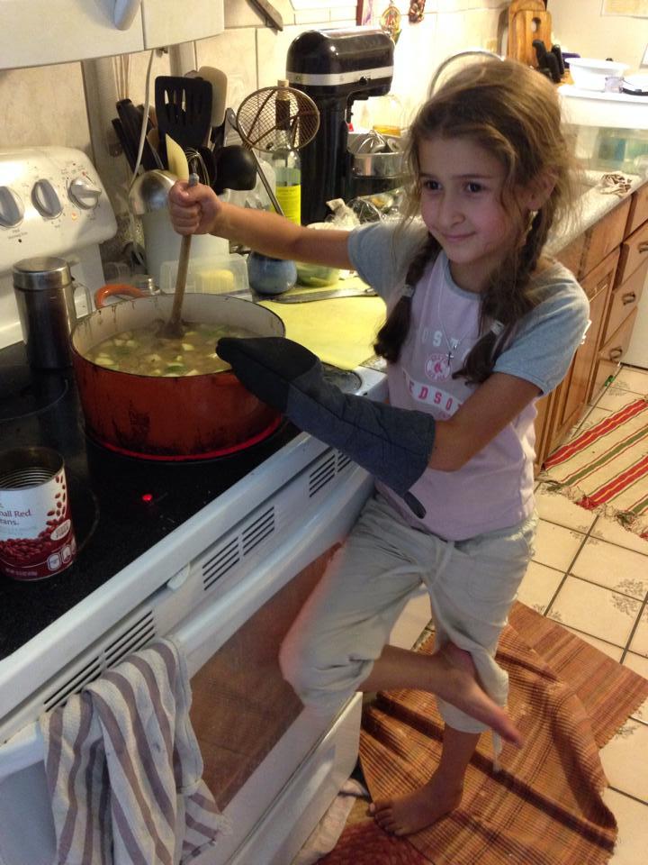 Bella makes soup.