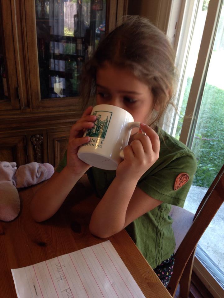 Bella sips coffee