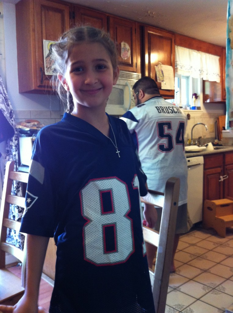 Bella in Patriot's jersey
