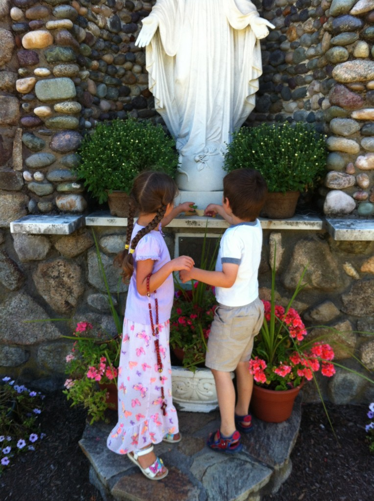 Sophie and Ben giving flowers to Mary