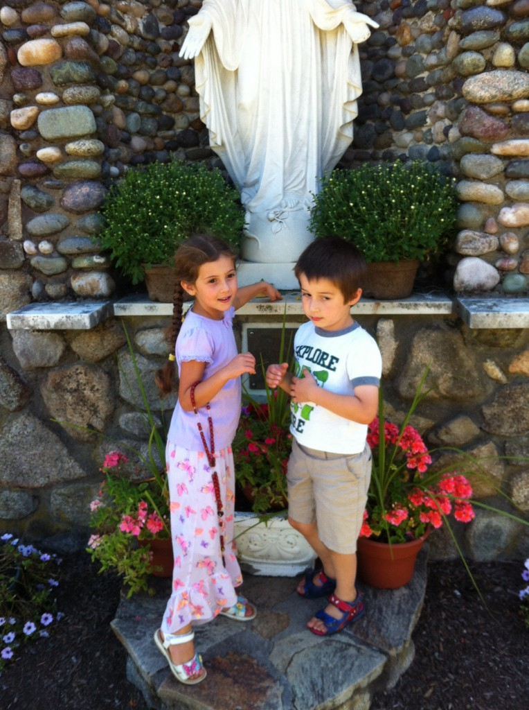 Sophie and Ben with Mary statue