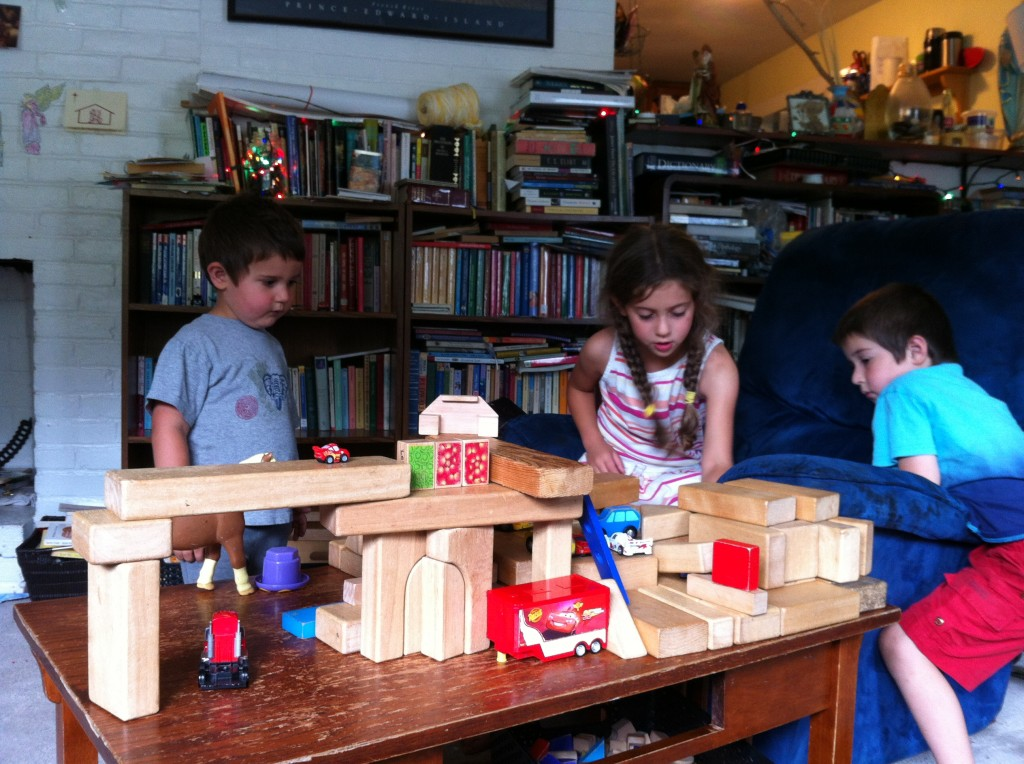 Three kids playing together so nicely. I love the elaborate block structures.