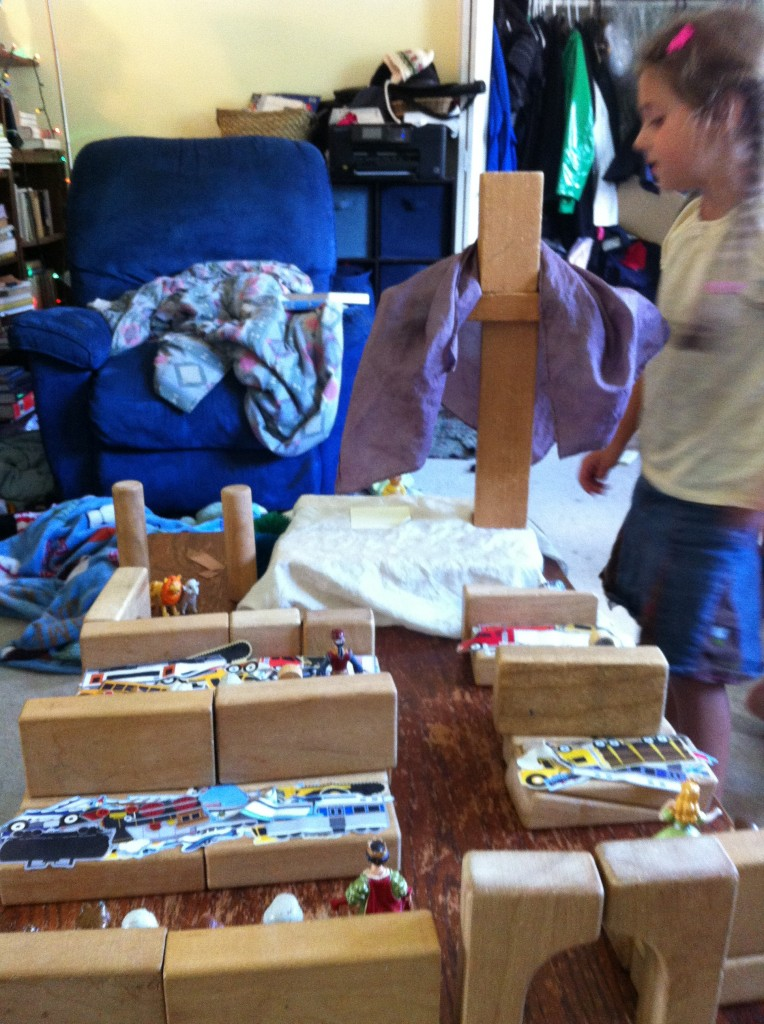 Block church with altar, cross, pews, kneelers. This is how children build relationships to the abstract, through play.