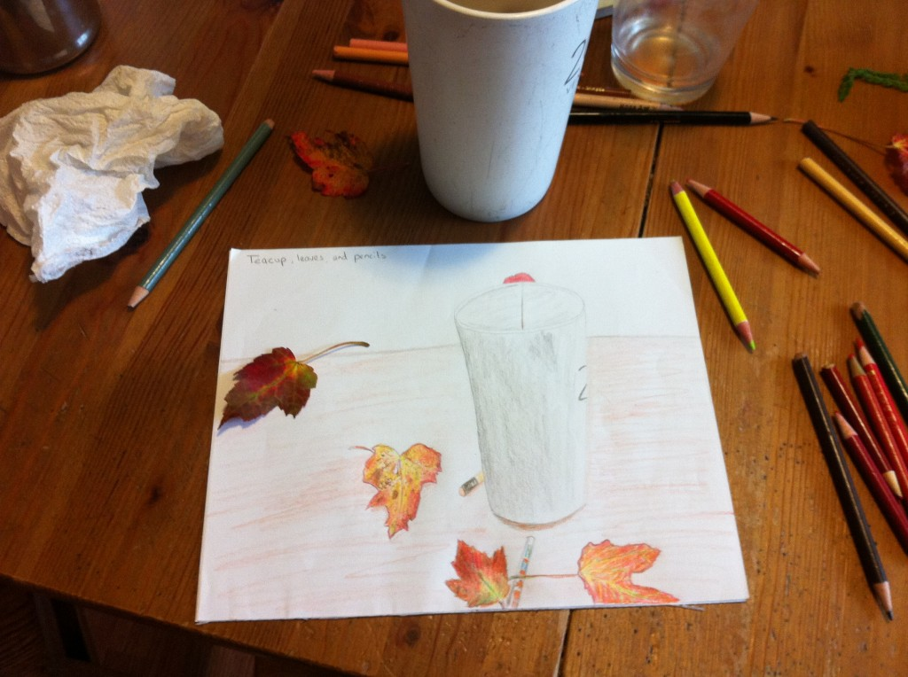 cup and leaves and pencils