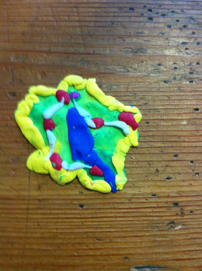 Bella's island. The blue is a river, the red dots are houses, the yellow is sandy beaches.