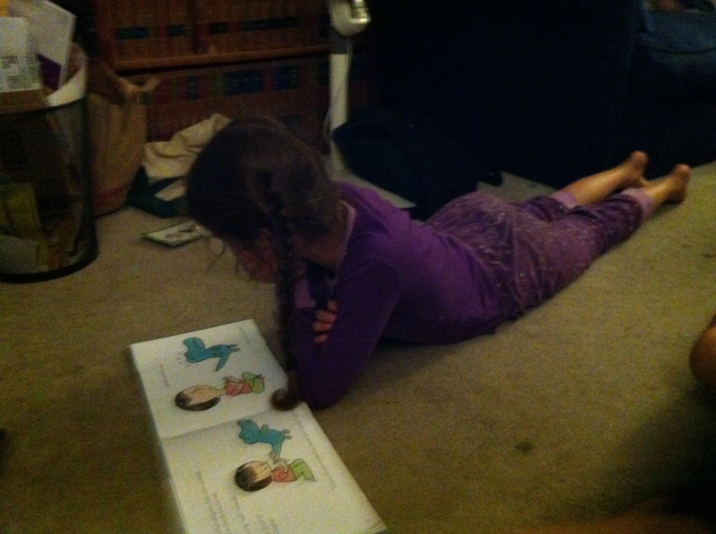 Bella reads Amanda and Her Amazing Alligator.