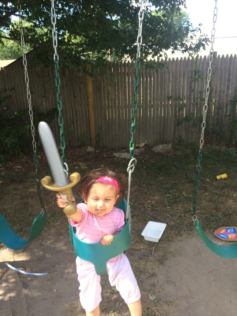 Lucy in the swing with a sword