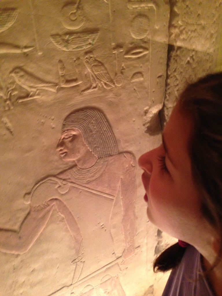 Looking at inscriptions in an Egyptian funerary chapel