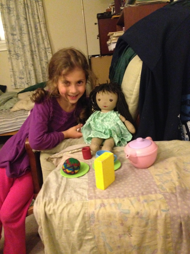 Sophie throws a tea party for her well-dressed dolly. (Then Lucy takes over.)