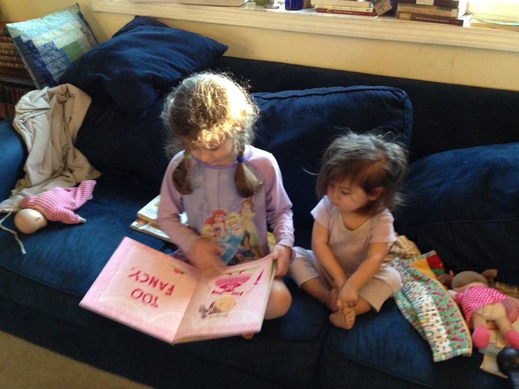 Sophie reads to Lucy