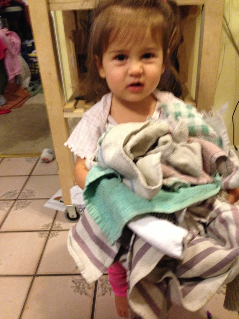 Lucy puts away the towels