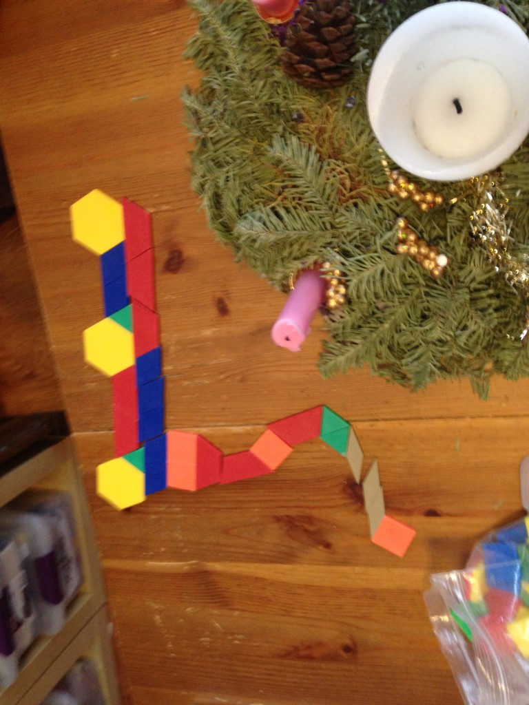 Ben makes a cherry picker truck out of pattern blocks