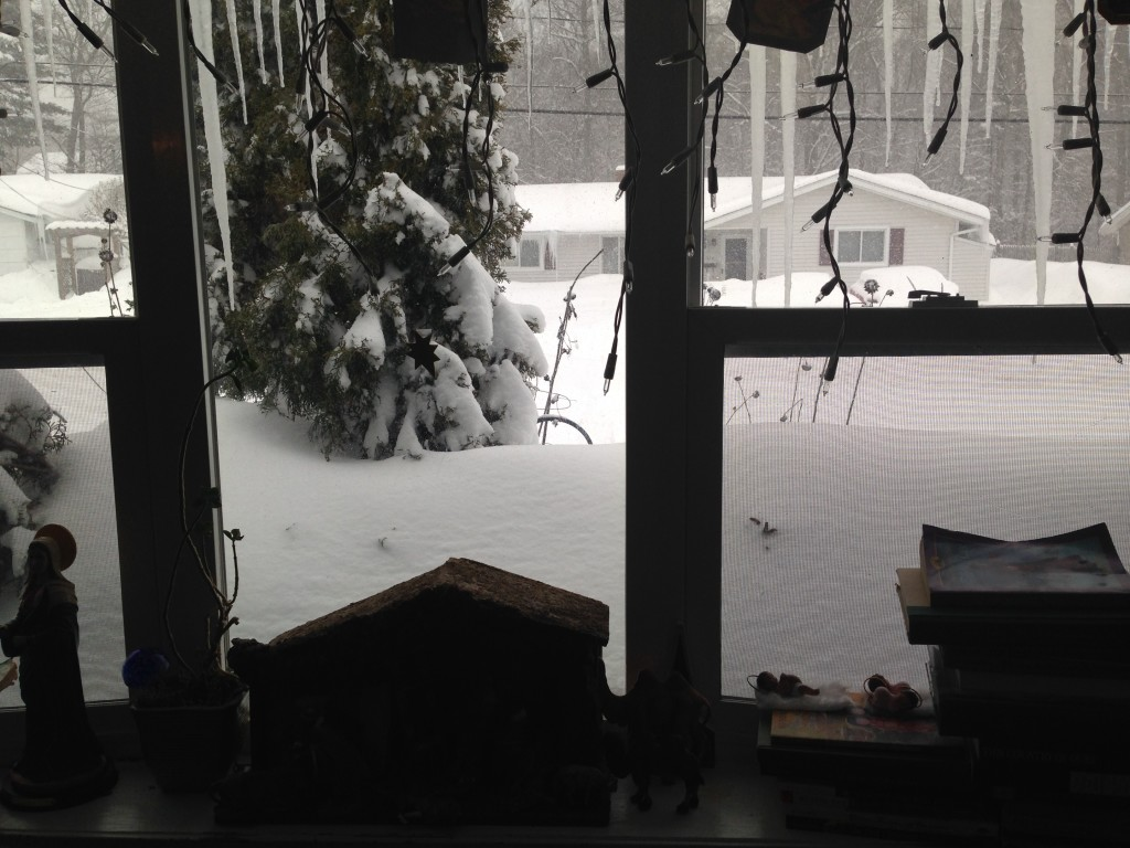Snow drifts higher than the front window sill.