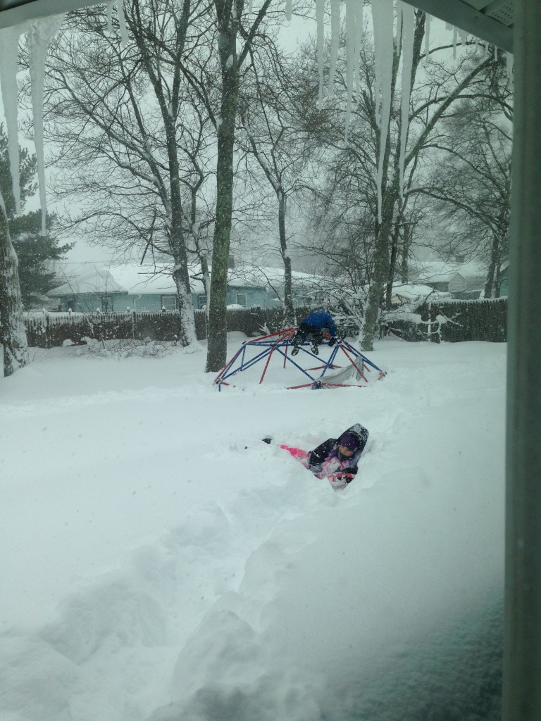 Sophie and Ben playing in the snow.