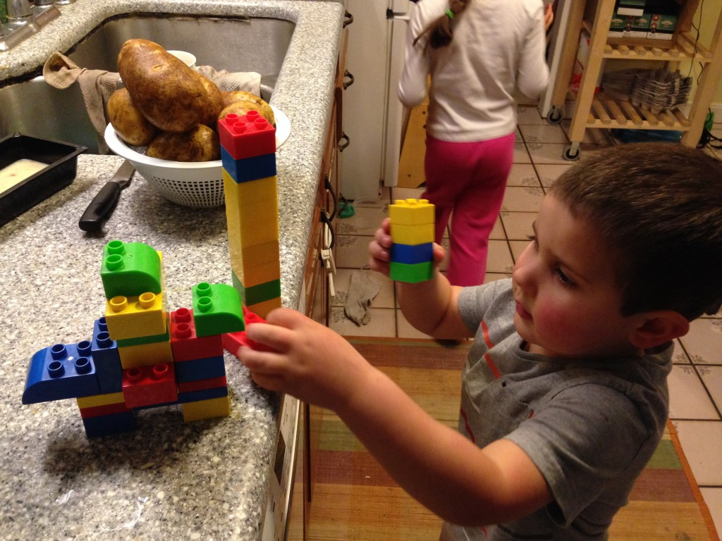 Anthony builds a lego man on a lego horse with a lego lance.
