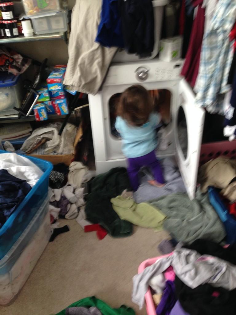 Lucy empties the dryer.