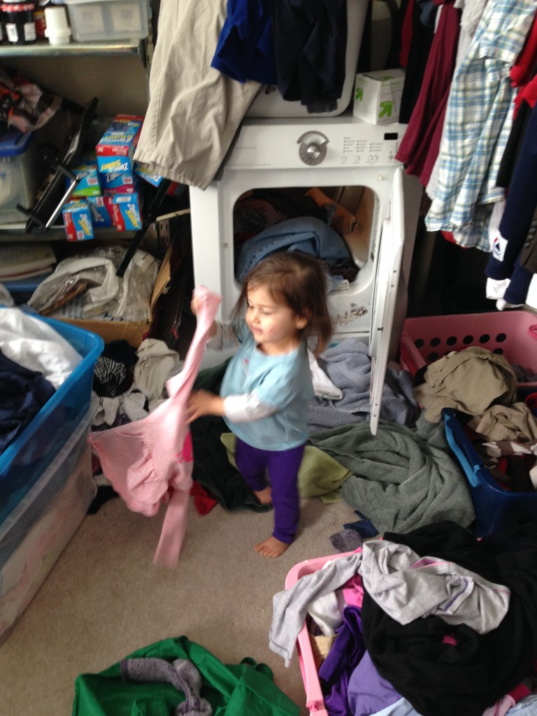 """I glanced into the laundry room and Lucy announced, """"Clothes done drying!"""" She opened the dryer and sorted the clothes into the proper bins all by herself. Everything but the things that were """"too big."""" She knows which things belong to who."""
