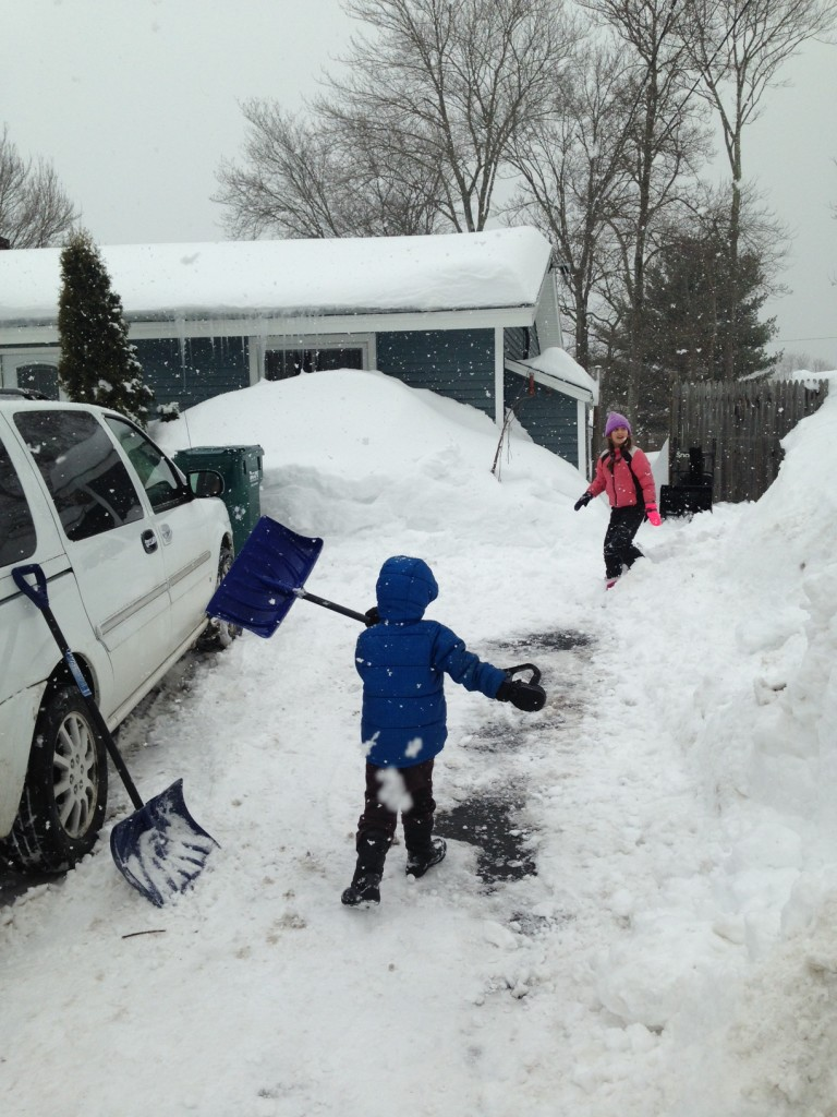 Ben helps to shovel the drive