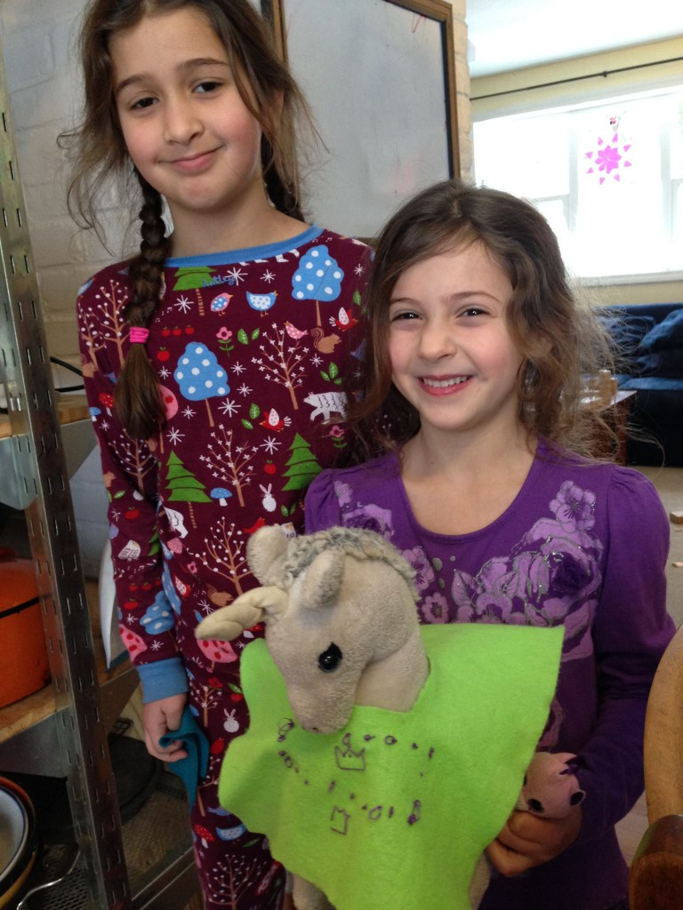 Bella made an embroidered dress for Sophie's unicorn, Star.