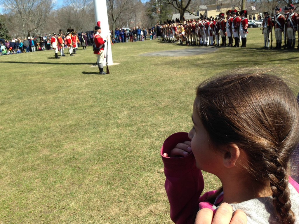 Bella watches the redcoats mustering