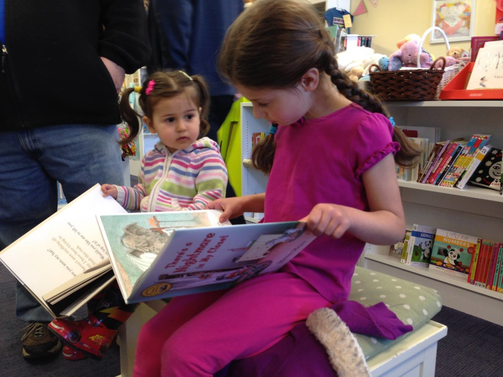 In the children's bookstore, Sophie and Lucy reading