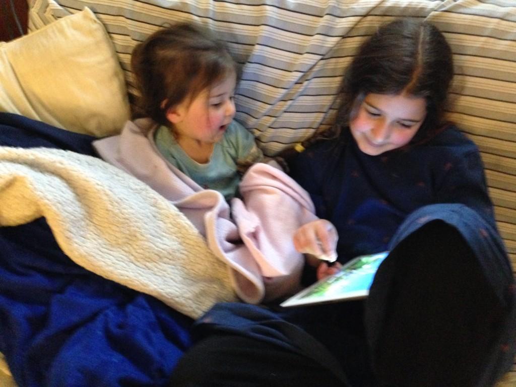 Big sister entertains sick baby sister