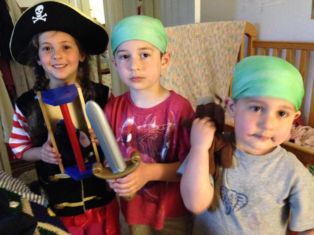 Three pirates. Sophie put the grackle in the tool box to be the pirate's parrot in a cage.