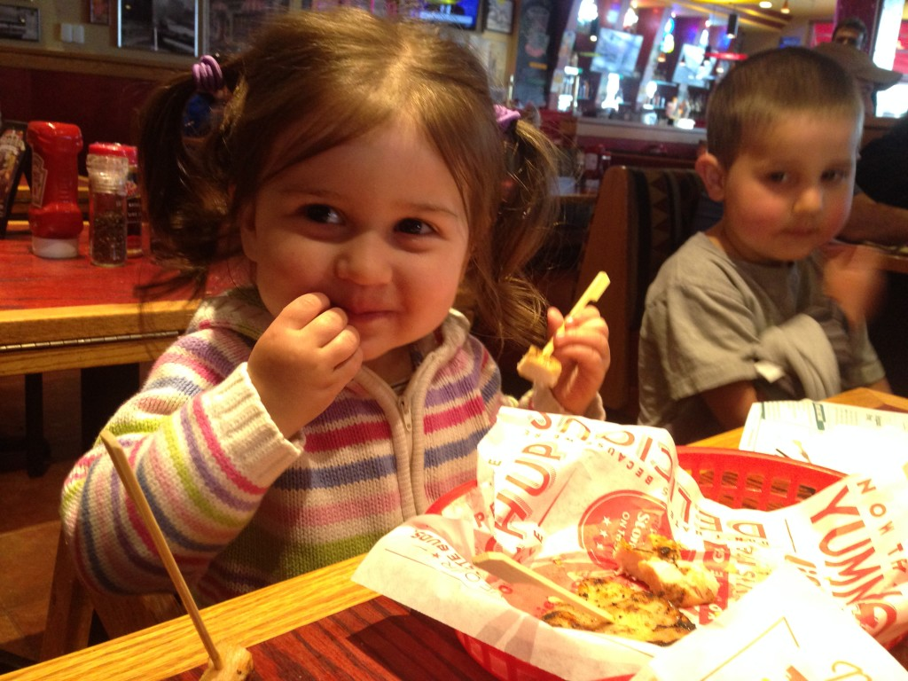 Lucy enjoys her chicken at Red Robin