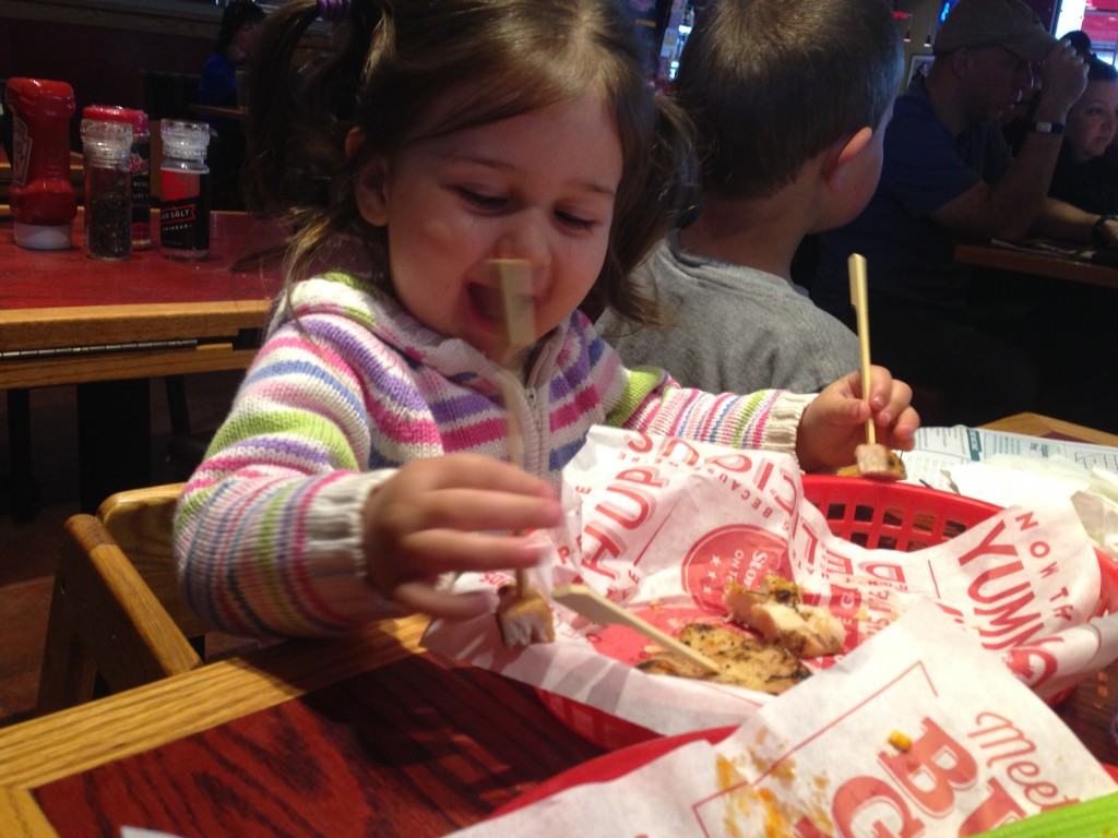 Lucy enjoys her chicken at Red Robin and does a little Charlie Chaplin number.